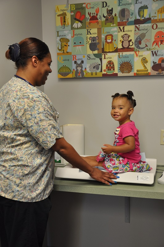 Northside Pediatrics Nurse with Patient